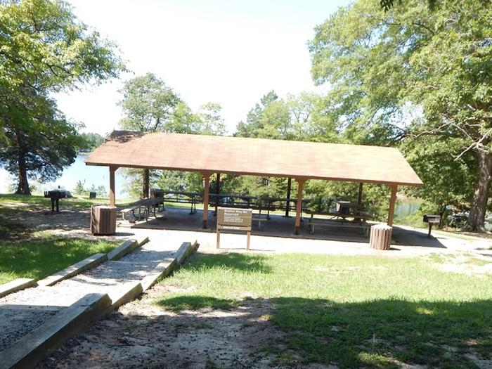 OSAGE Picnic ShelterWelcome to North Bend Park! This is a picture of the OSAGE Shelter that can be rented for the day inside the park. The OSAGE Shelter is only for day users. This shelter has electricity and has a water spigot. There are picnic tables and grills for your use as well.