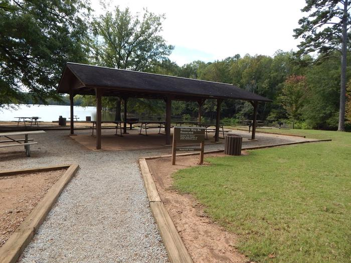Longwood Picnic ShelterWelcome to Longwood Park! This is a picture of the day use shelter that can be reserved online! There are picnic tables and grills for you to use. This shelter does not have electricity or water avaliable. There are vault toilets near by as well as a playground for the kids! This is a great area to have a birthday party!