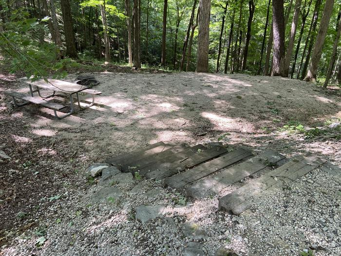 Steps lead down to table and tent area