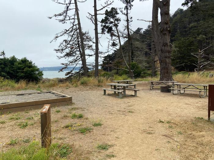 Site 2 in July with tent pads, a food locker, and three picnic tables.Site 2 in July