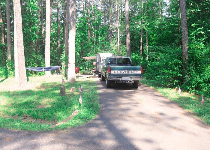 Driveway slope, awning-side clearance.Sweetwater Campground Site 119