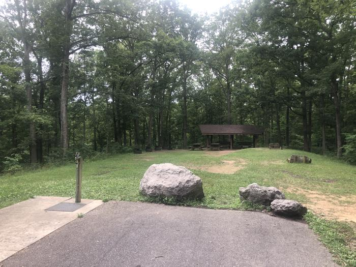 A photo of Site 001 of Loop 2 Point at LAKE VESUVIUS RECREATION AREA with Picnic Table, Fire Pit, Shade, Water Hookup, Lean To / Shelter