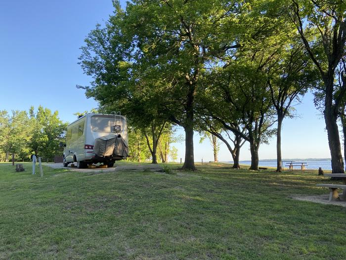 A photo of Site 16 of Loop BCRC at BEAR CREEK COVE with Electricity Hookup, Shade, Waterfront, Water Hookup