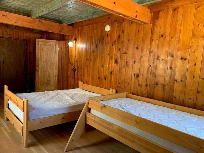 Sollers bedroom with 2 bedsSollers Cabin bedroom with two beds.