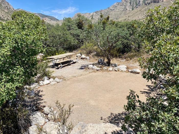 Another view of the tent site number 19.  The site is surrounded by desert vegetation and has views of the Guadalupe Mountains.Tent campsite #19. tent pad and table with views of the Guadalupe Mountains.