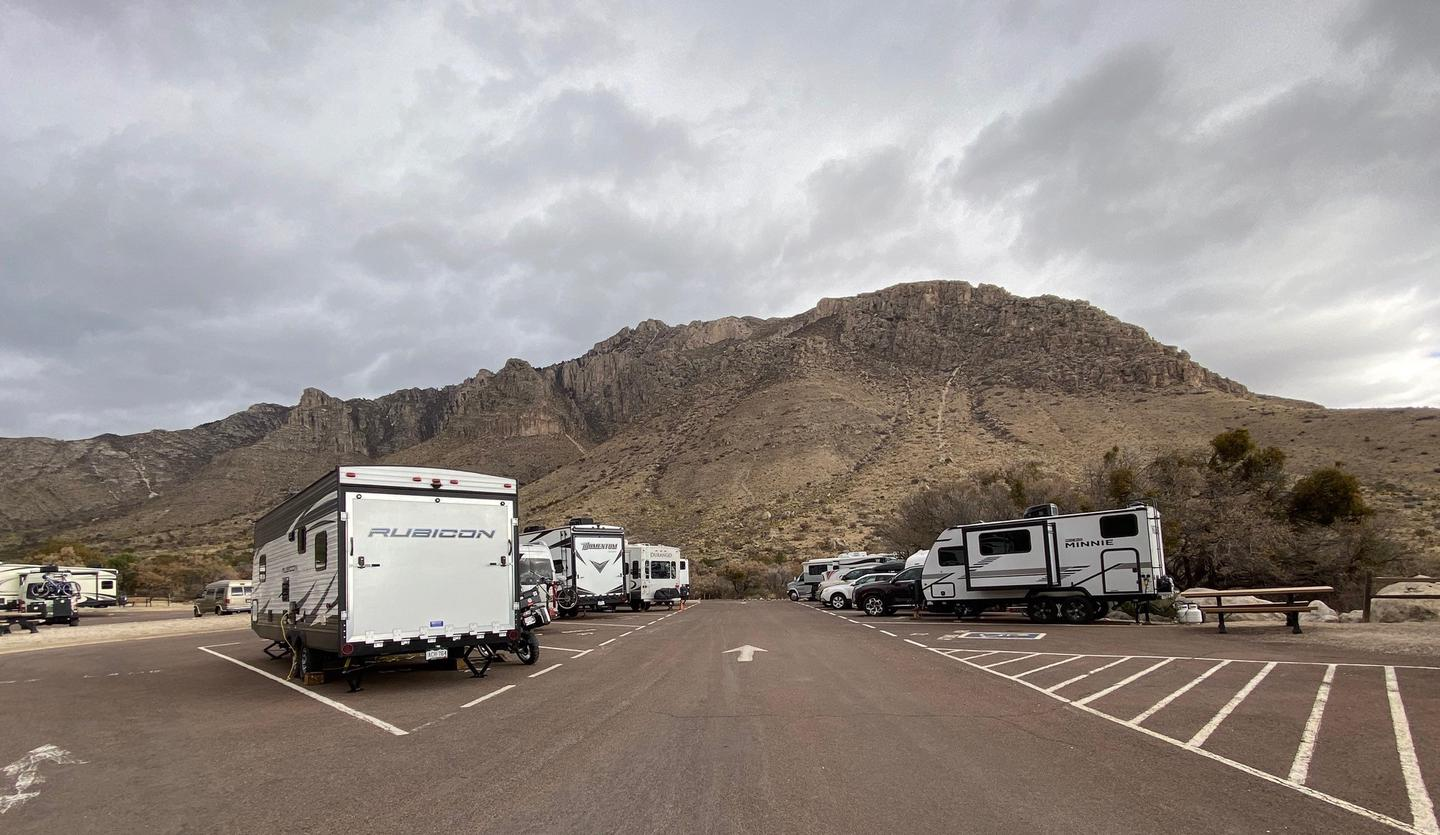 RV campsite 21 is the first site to the right in the photo and is unoccupied.  This photo shows the line of RVs in adjoining sites.Accessible RV Campsite 21 is the unoccupied spot to the right side of the photo.