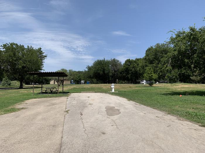 A photo of Site 002 of Loop PPAT at Holiday (Texas) with Picnic Table, Electricity Hookup, Fire Pit, Water Hookup