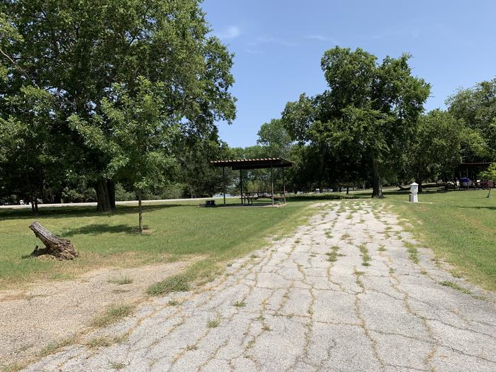 A photo of Site 027 of Loop PPAT at Holiday (Texas) with Picnic Table, Electricity Hookup