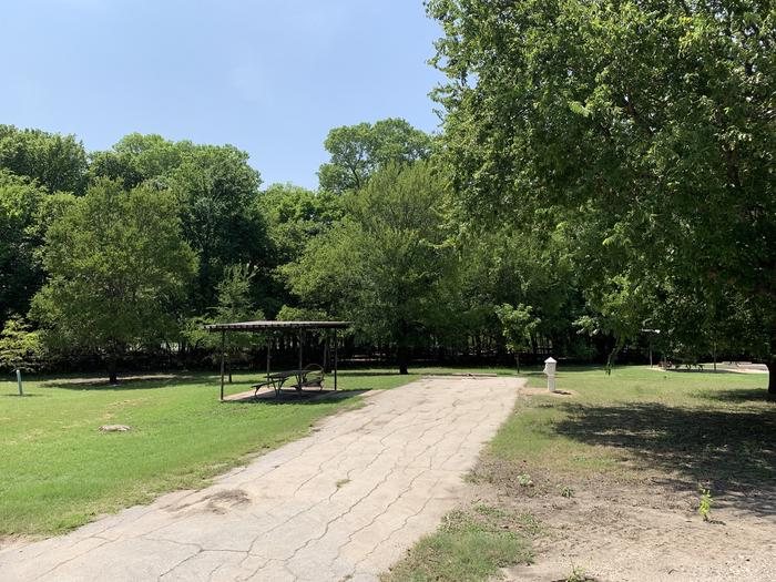 A photo of Site 013 of Loop PPAT at Holiday (Texas) with Picnic Table, Electricity Hookup, Water Hookup