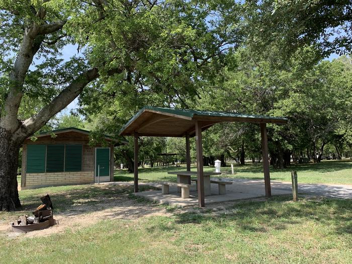 A photo of Site 060 of Loop SOUT at Holiday (Texas) with Picnic Table, Electricity Hookup, Water Hookup
