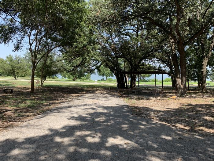 A photo of Site 034 of Loop SOUT at Holiday (Texas) with Picnic Table, Electricity Hookup, Shade, Water Hookup