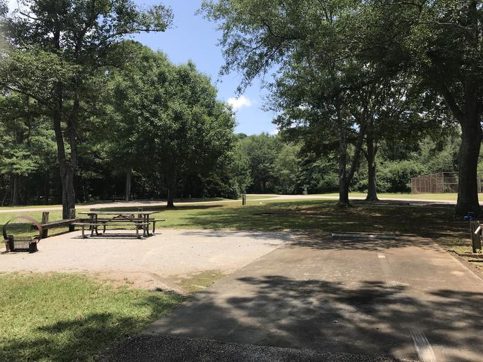 A photo of Site 073 of Loop LOOG at Holiday (Georgia) with Picnic Table, Electricity Hookup, Shade, Lantern Pole, Water Hookup