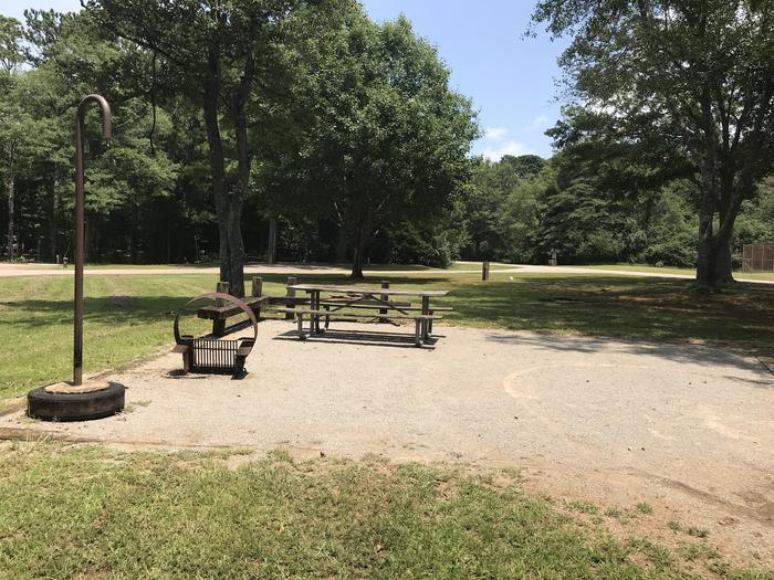 A photo of Site 073 of Loop LOOG at Holiday (Georgia) with Electricity Hookup, Fire Pit, Shade, Lantern Pole, Water Hookup