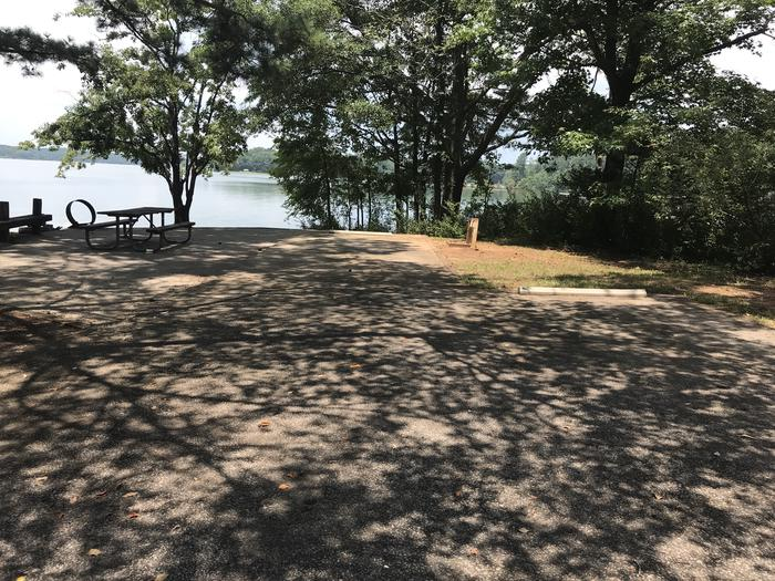 A photo of Site 072 of Loop LOOG at Holiday (Georgia) with Picnic Table, Electricity Hookup, Fire Pit, Shade, Tent Pad, Waterfront, Lantern Pole, Water Hookup