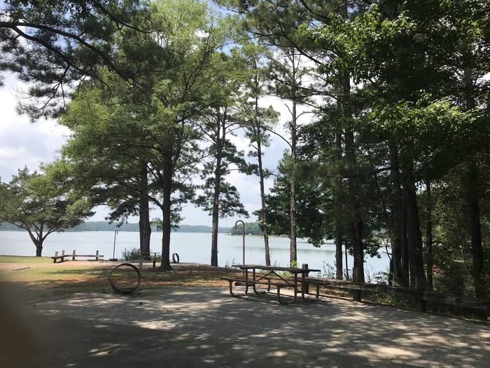 A photo of Site 069 of Loop LOOG at Holiday (Georgia) with Picnic Table, Electricity Hookup, Fire Pit, Shade, Waterfront, Lantern Pole, Water Hookup