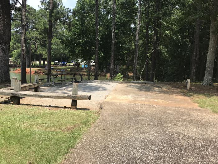 A photo of Site 070 of Loop LOOG at Holiday (Georgia) with Picnic Table, Electricity Hookup, Fire Pit, Waterfront, Lantern Pole, Water Hookup