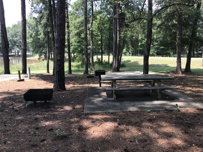 A photo of Site KK-02 of Loop LOOL at Holiday (Georgia) with Picnic Table, Electricity Hookup, Shade, Tent Pad, Waterfront, Lantern Pole, Water Hookup