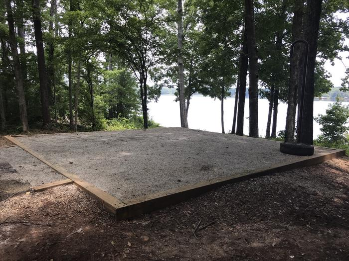 A photo of Site 094 of Loop LOOI at Holiday (Georgia) with Picnic Table, Electricity Hookup, Fire Pit, Shade, Tent Pad, Waterfront, Lantern Pole, Water Hookup