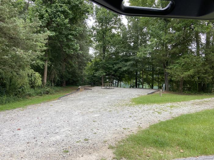 A photo of Site 79 of Loop SPRINGFIELD  at SPRINGFIELD with Picnic Table, Electricity Hookup, Fire Pit, Shade, Tent Pad, Waterfront, Lantern Pole, Water Hookup