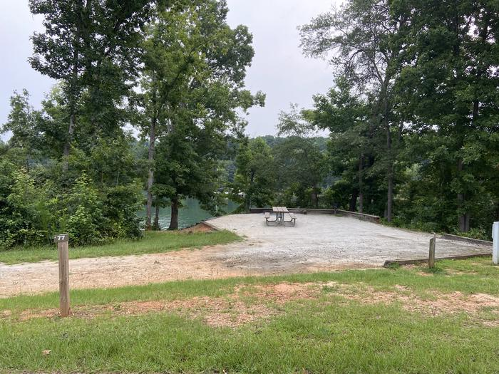 A photo of Site 77 of Loop SPRINGFIELD  at SPRINGFIELD with Picnic Table, Electricity Hookup, Fire Pit, Shade, Tent Pad, Waterfront, Lantern Pole, Water Hookup