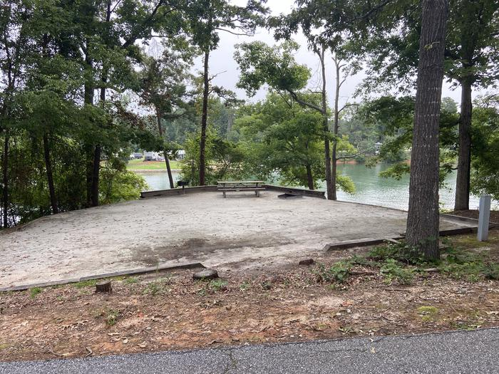 A photo of Site 63 of Loop SPRINGFIELD  at SPRINGFIELD with Picnic Table, Electricity Hookup, Fire Pit, Shade, Tent Pad, Waterfront, Lantern Pole, Water Hookup