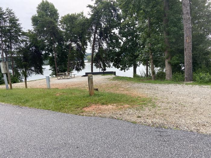 A photo of Site 55 of Loop SPRINGFIELD  at SPRINGFIELD with Picnic Table, Electricity Hookup, Fire Pit, Shade, Tent Pad, Waterfront, Lantern Pole, Water Hookup