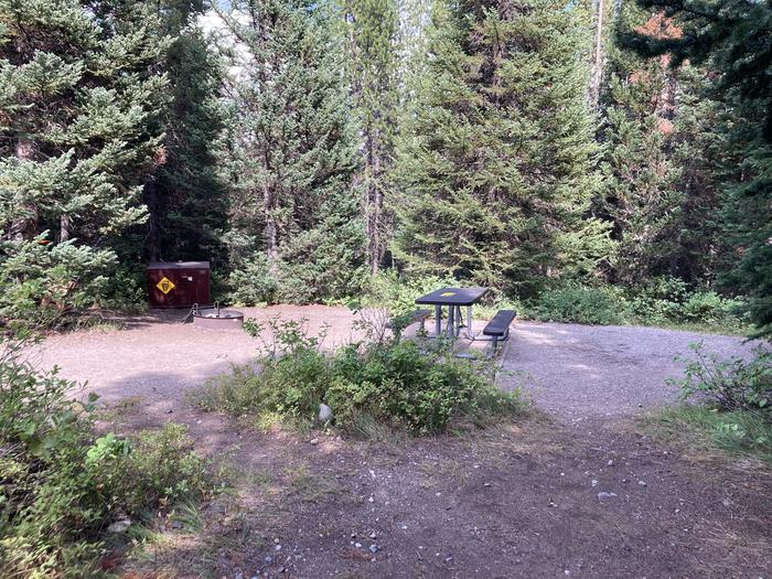 A photo of Site 130 of Loop F at Colter Bay Campground with Picnic Table, Fire Pit, Food Storage, Tent Pad