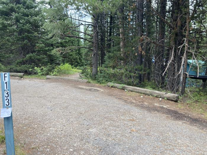 A photo of Site 133 of Loop F at Colter Bay Campground with Picnic Table, Fire Pit, Food Storage, Tent Pad