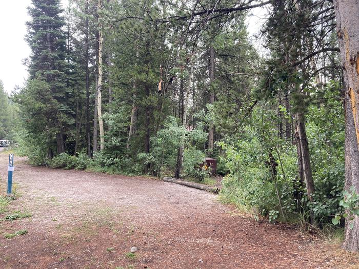 A photo of Site 66 of Loop C at Colter Bay Campground with Picnic Table, Fire Pit, Food Storage
