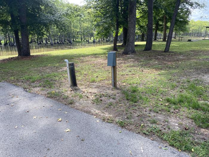 A photo of Site 35 of Loop MAGNOLIA RIDGE  at MAGNOLIA RIDGE with Electricity Hookup, Waterfront, Water Hookup