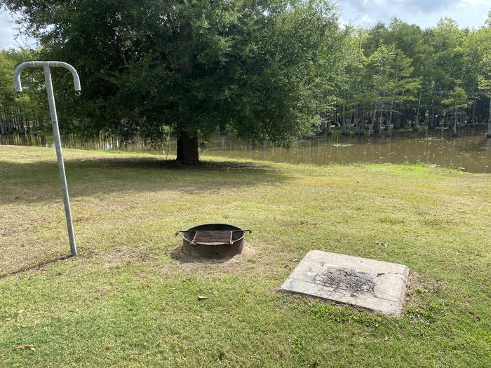 A photo of Site 32 of Loop MAGNOLIA RIDGE  at MAGNOLIA RIDGE with Fire Pit, Waterfront, Lantern Pole