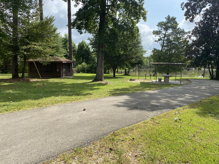 A photo of Site 36 of Loop MAGNOLIA RIDGE  at MAGNOLIA RIDGE with Picnic Table, Electricity Hookup, Fire Pit, Shade, Waterfront, Lantern Pole, Water Hookup