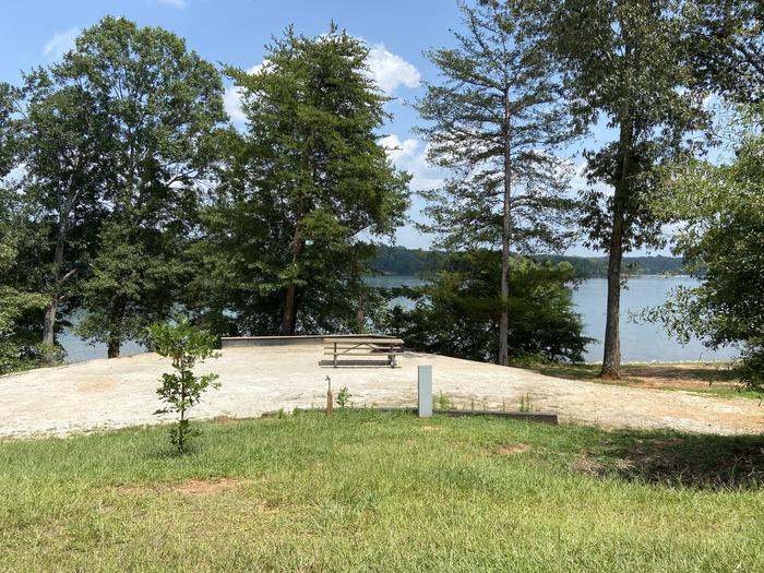 A photo of Site 58 of Loop SPRINGFIELD  at SPRINGFIELD with Picnic Table, Electricity Hookup, Fire Pit, Tent Pad, Waterfront, Lantern Pole, Water Hookup