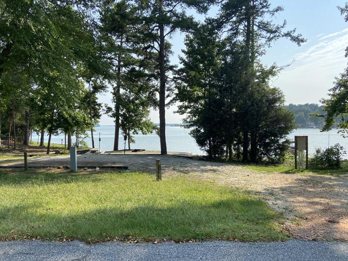 A photo of Site 14 of Loop SPRINGFIELD  at SPRINGFIELD with Picnic Table, Electricity Hookup, Fire Pit, Shade, Tent Pad, Waterfront, Lantern Pole, Water Hookup