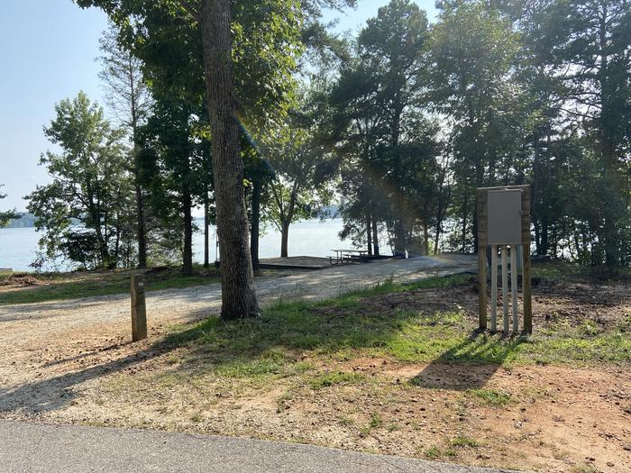 A photo of Site 16 of Loop SPRINGFIELD  at SPRINGFIELD with Picnic Table, Electricity Hookup, Fire Pit, Shade, Tent Pad, Waterfront, Lantern Pole