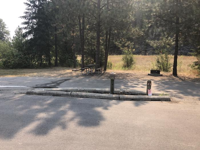 A photo of Site 21 of Loop A at Huckleberry Campground  with Picnic Table, Electricity Hookup, Fire Pit, Shade, Tent Pad, Water Hookup