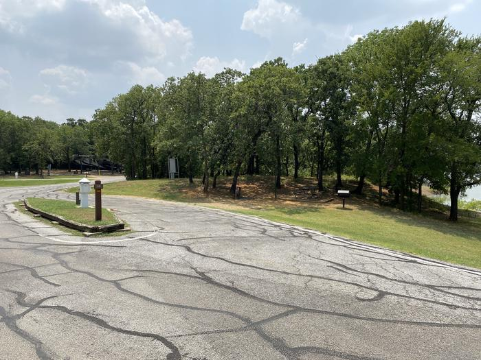 A photo of Site 011 of Loop HICKORY CREEK  at HICKORY CREEK with Boat Ramp, Picnic Table, Electricity Hookup, Fire Pit, Shade, Waterfront, Lantern Pole, Water Hookup