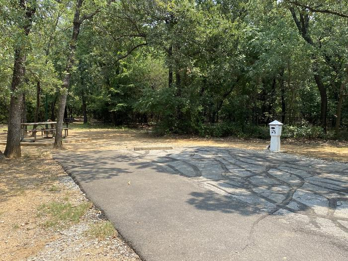 A photo of Site 016 of Loop HICKORY CREEK  at HICKORY CREEK with Boat Ramp, Picnic Table, Electricity Hookup, Fire Pit, Shade, Lantern Pole, Water Hookup