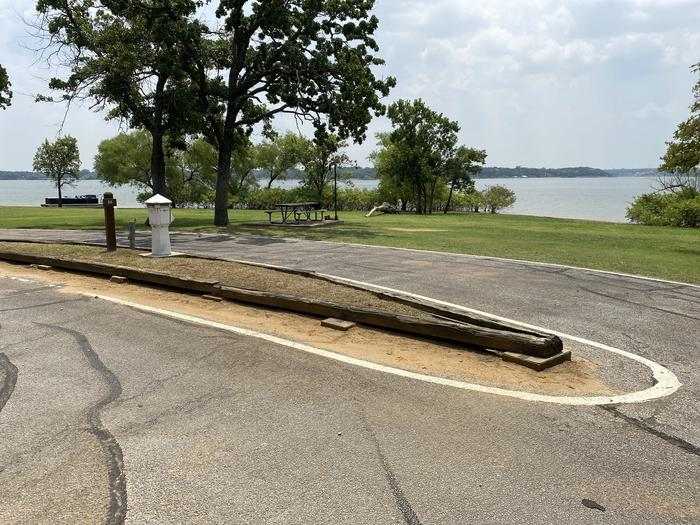 A photo of Site 026 of Loop HICKORY CREEK  at HICKORY CREEK with Boat Ramp, Picnic Table, Electricity Hookup, Fire Pit, Waterfront, Lantern Pole, Water Hookup
