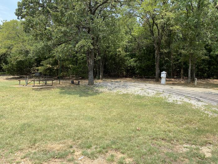 A photo of Site 031 of Loop HICKORY CREEK  at HICKORY CREEK with Boat Ramp, Picnic Table, Electricity Hookup, Fire Pit, Shade, Lantern Pole, Water Hookup