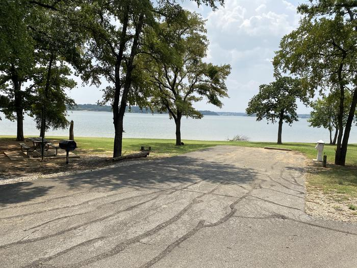 A photo of Site 030 of Loop HICKORY CREEK  at HICKORY CREEK with Boat Ramp, Picnic Table, Electricity Hookup, Fire Pit, Shade, Waterfront, Lantern Pole, Water Hookup