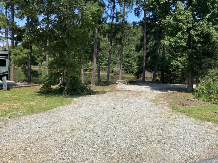 A photo of Site 02 of Loop SPRINGFIELD  at SPRINGFIELD with Picnic Table, Electricity Hookup, Fire Pit, Shade, Tent Pad, Waterfront, Lantern Pole