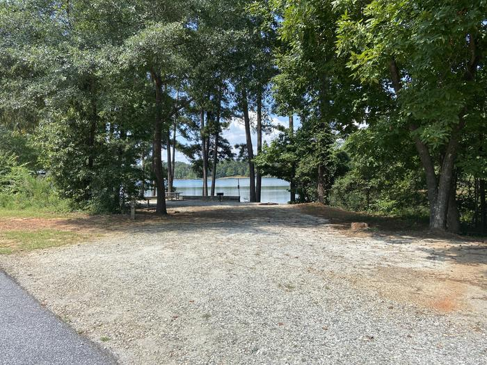 A photo of Site 02 of Loop SPRINGFIELD  at SPRINGFIELD with Picnic Table, Electricity Hookup, Fire Pit, Shade, Tent Pad, Waterfront, Water Hookup