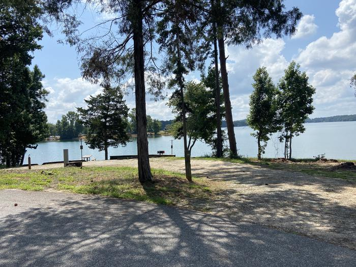 A photo of Site 18 of Loop SPRINGFIELD  at SPRINGFIELD with Picnic Table, Electricity Hookup, Fire Pit, Shade, Tent Pad, Waterfront, Lantern Pole, Water Hookup