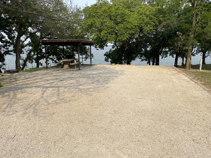 A photo of Site 16 of Loop CCRE at CANNING CREEK with Picnic Table, Electricity Hookup, Fire Pit, Shade, Waterfront, Water Hookup
