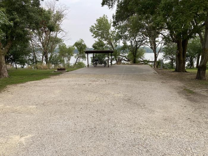 A photo of Site 43 of Loop CCRE at CANNING CREEK with Picnic Table, Electricity Hookup, Fire Pit, Shade, Waterfront, Water Hookup