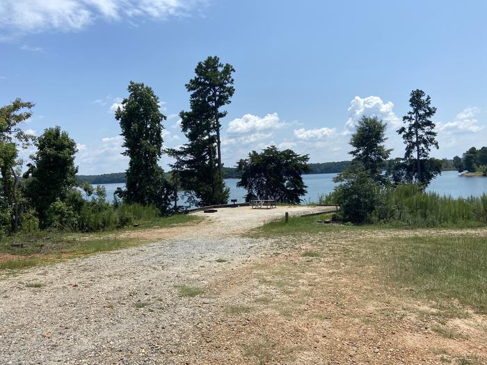A photo of Site 74 of Loop SPRINGFIELD  at SPRINGFIELD with Picnic Table, Electricity Hookup, Fire Pit, Shade, Tent Pad, Waterfront, Lantern Pole, Water Hookup