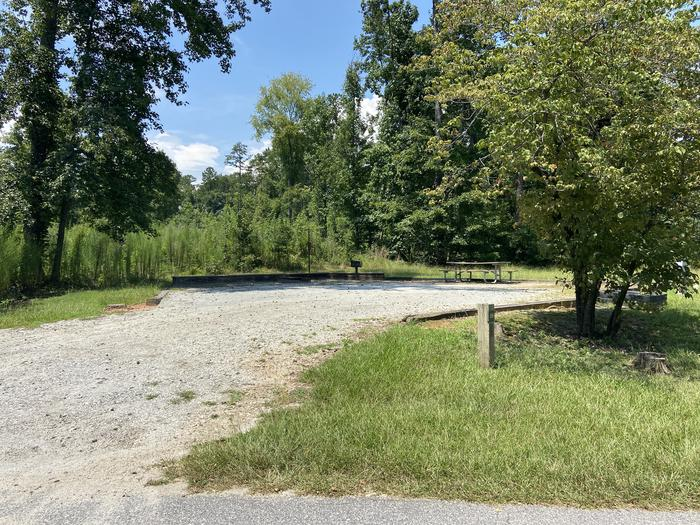 A photo of Site 26 of Loop SPRINGFIELD  at SPRINGFIELD with Picnic Table, Electricity Hookup, Sewer Hookup, Fire Pit, Shade, Tent Pad, Full Hookup, Lantern Pole, Water Hookup