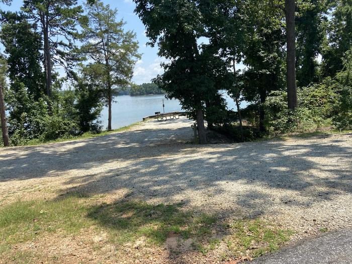 A photo of Site 53 of Loop SPRINGFIELD  at SPRINGFIELD with Picnic Table, Electricity Hookup, Fire Pit, Shade, Tent Pad, Waterfront, Lantern Pole, Water Hookup