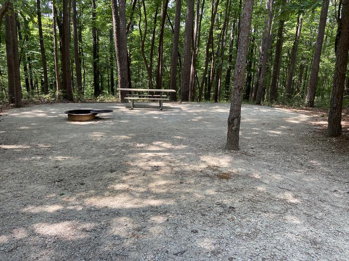 A photo of Site 184 of Loop PINE at HARDIN RIDGE with Picnic Table, Electricity Hookup, Fire Pit, Shade, Tent Pad, Lantern Pole, Water Hookup. Beautiful shaded site